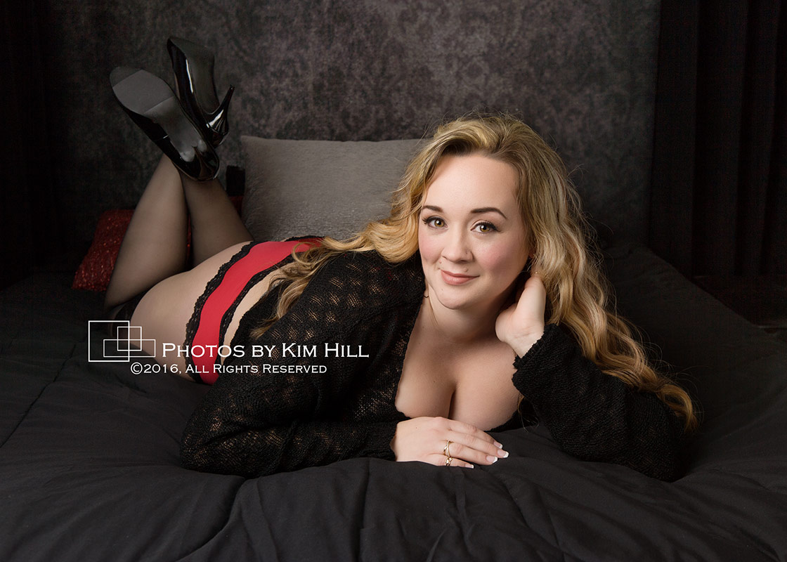 Boudoir photo session black sweater with red panties